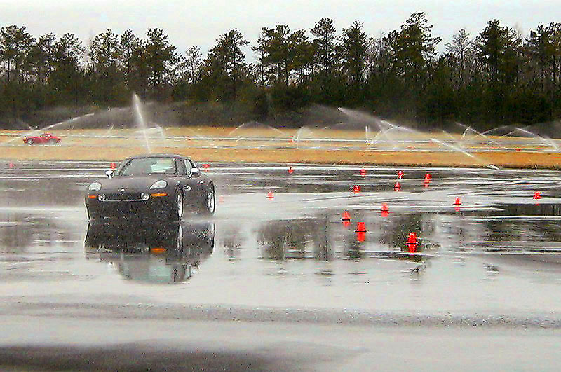 Standing water on polished asphalt at the Laurens Proving Grounds... spin-outs galore! (Z8Rookie 2/03)